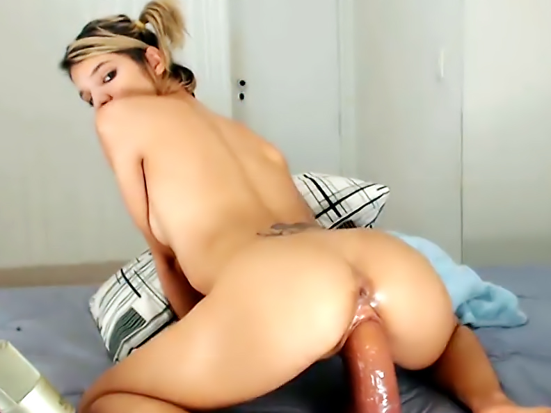 Massive sex toy is getting inserted