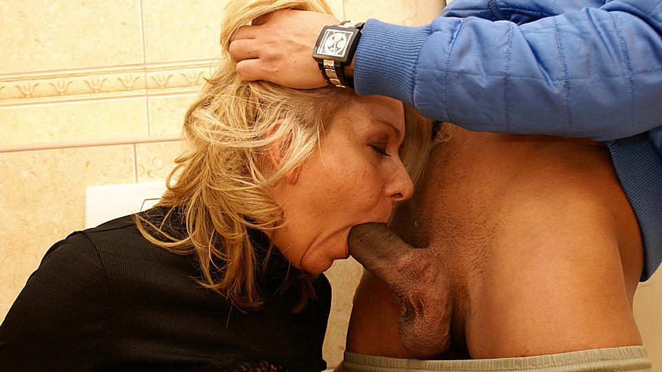 She licks ass, fucks and sucks on a public toilet