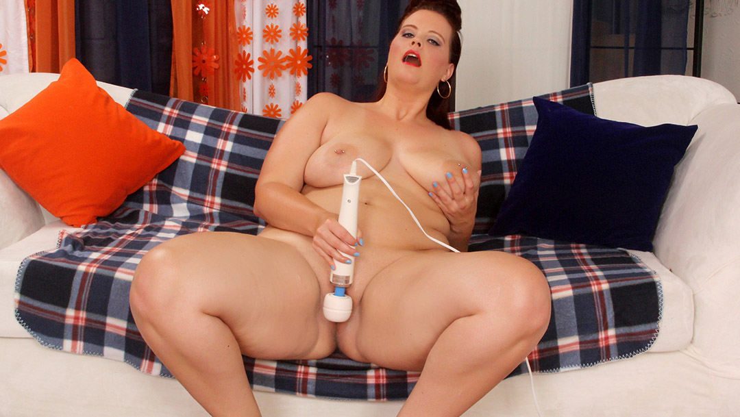 Big ass and big boobed girl using magic wand