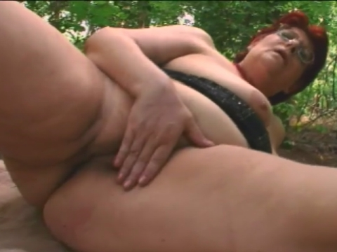 A slutty redhead granny blows big hard penis then rides it in a forest