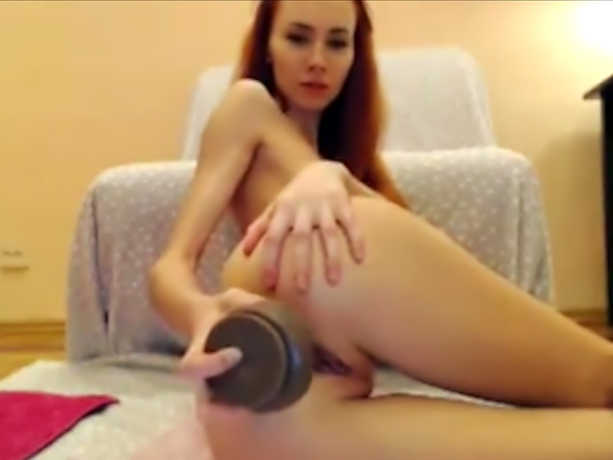 Redhead chick toying her asshole