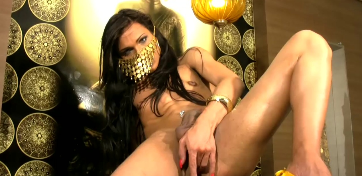 Mysterious tranny with big cock is stripping and jerking