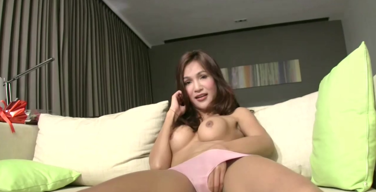 Long haired ladyboy in pink panties jerks off her big dick