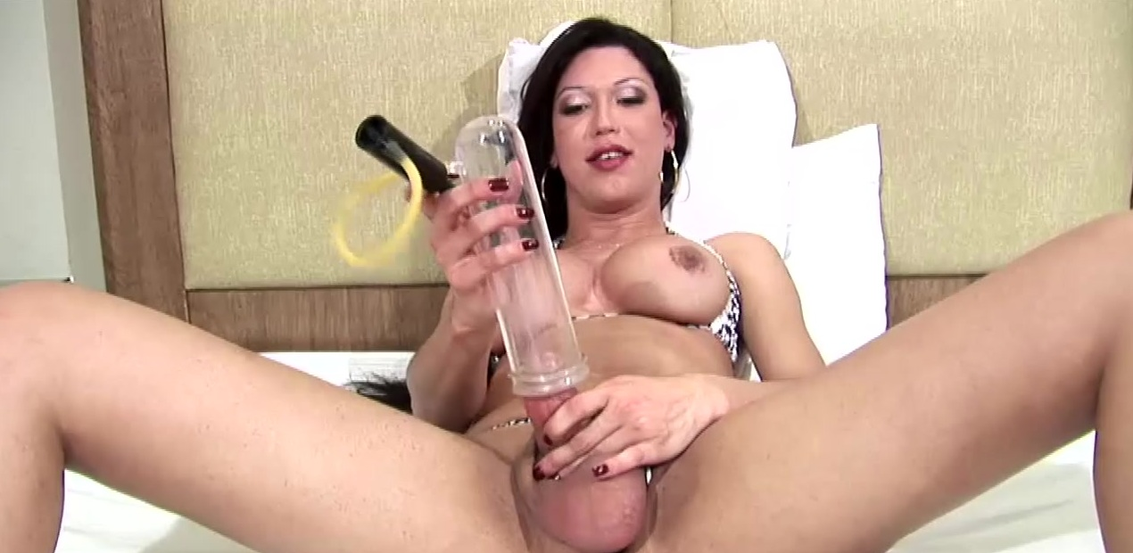 Big ass tgirl in tight bikini pumps her cock to monster size
